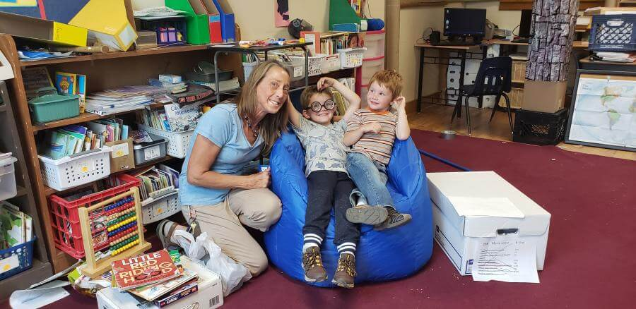 "Mrs. Maria Seesz at St. Peters Lutheran School in MV with some students trying out the new bean bag ""reading"" chair."