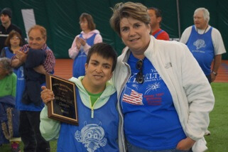 SLV Health CEO Konnie Martin stands with Karie Valdez at the Special Olympics.