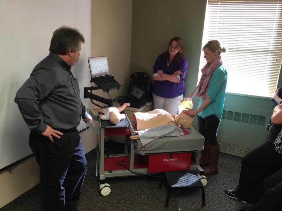 Tiffany Hoover tries out a resuscitation simulation.