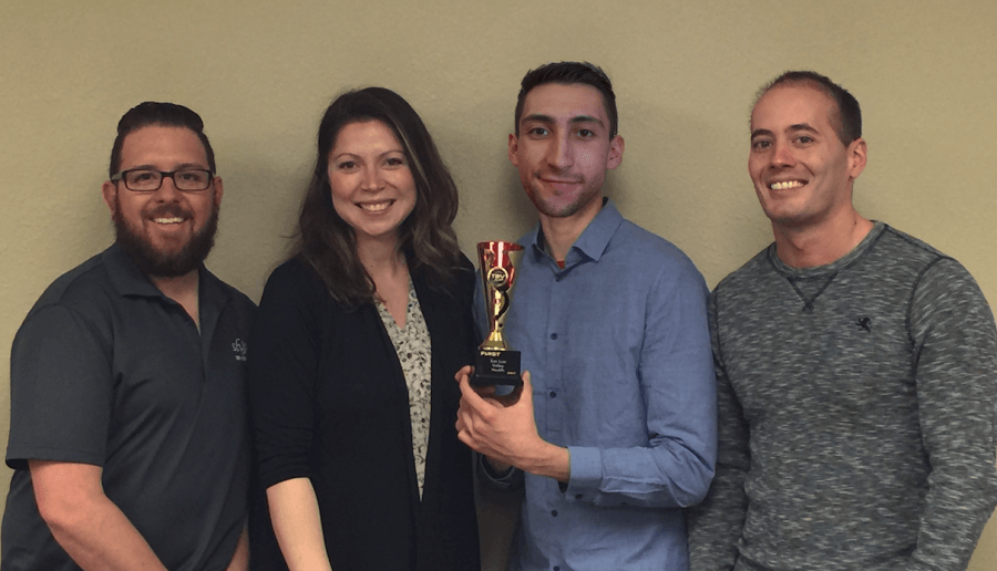 production team with award