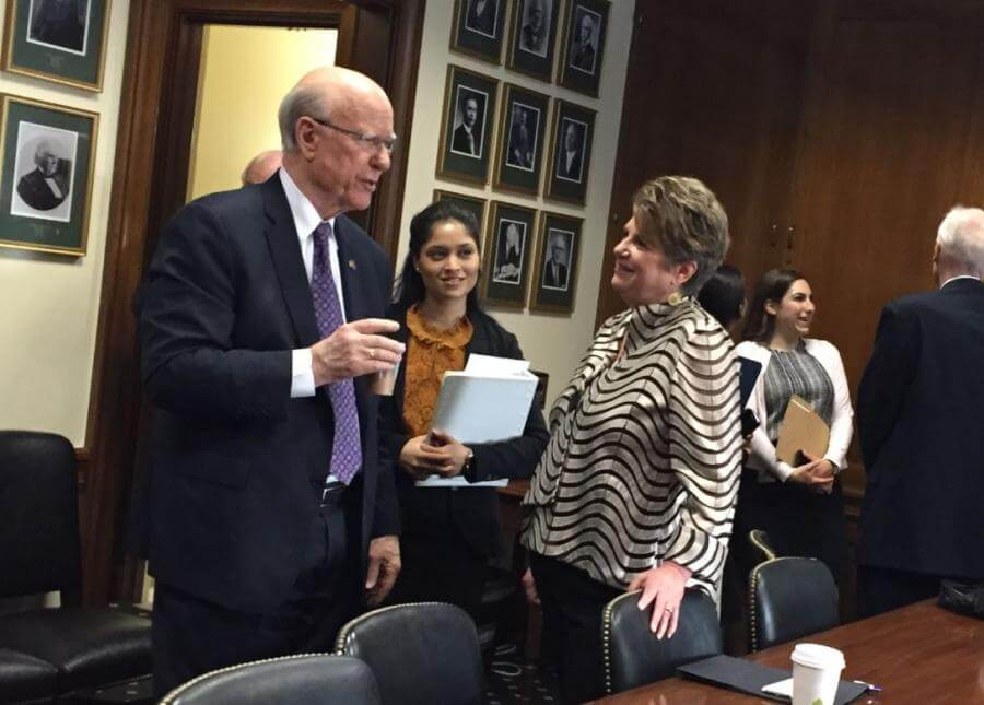 In the briefing room before the hearing, Konnie visits with Senator Roberts