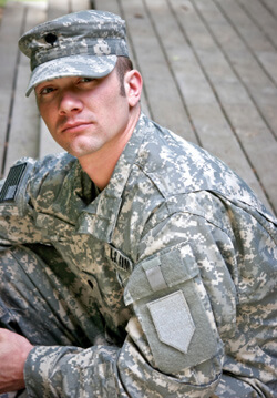 Man wearing ACU army fatigues.